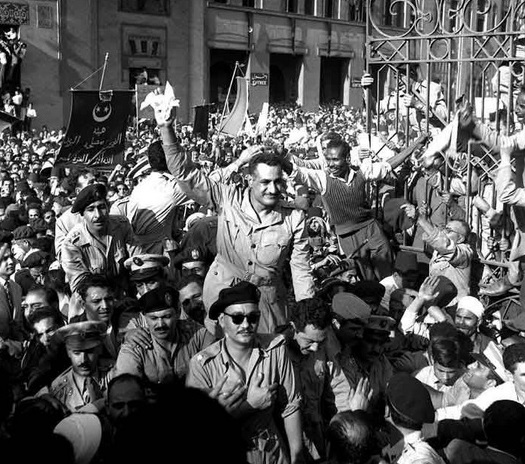 General Nasser (center of picture with hand in the air), Alexandria, Egypt, 1954.