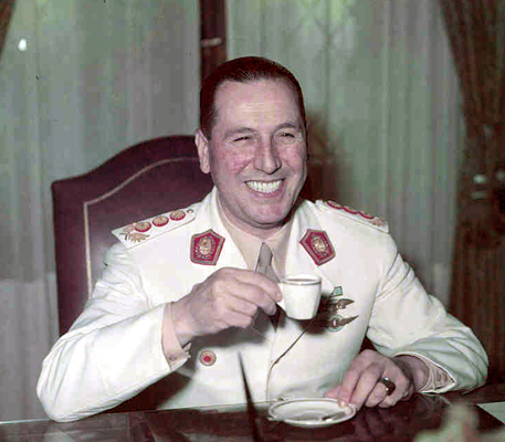 General Juan Peron in uniform, drinking coffee.