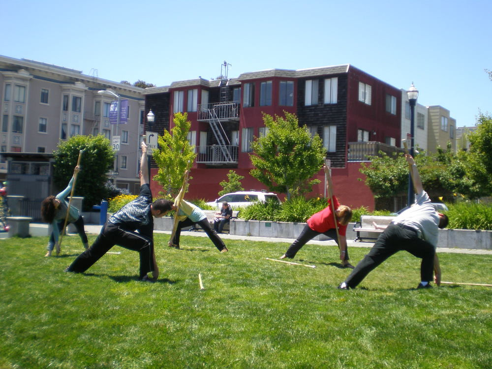 Dynamic Stick Stretching outside at Patricia's Green (in Hayes Valley).