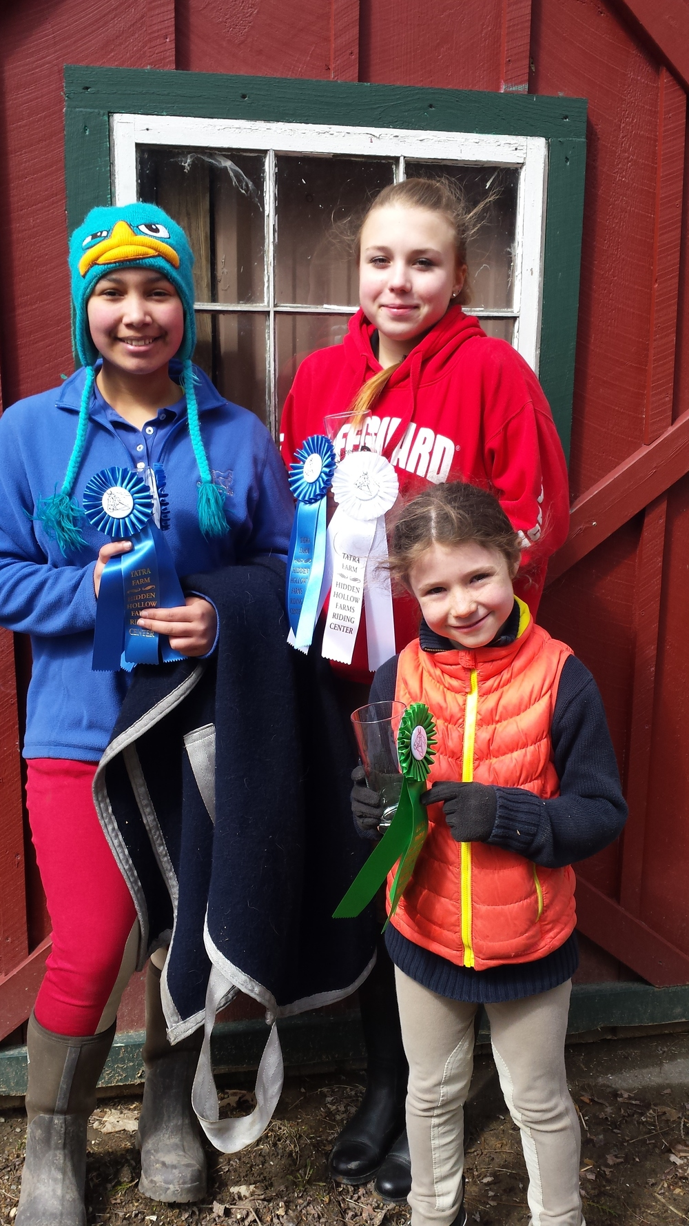 Tyra, Ola and Katherine with their ribbons