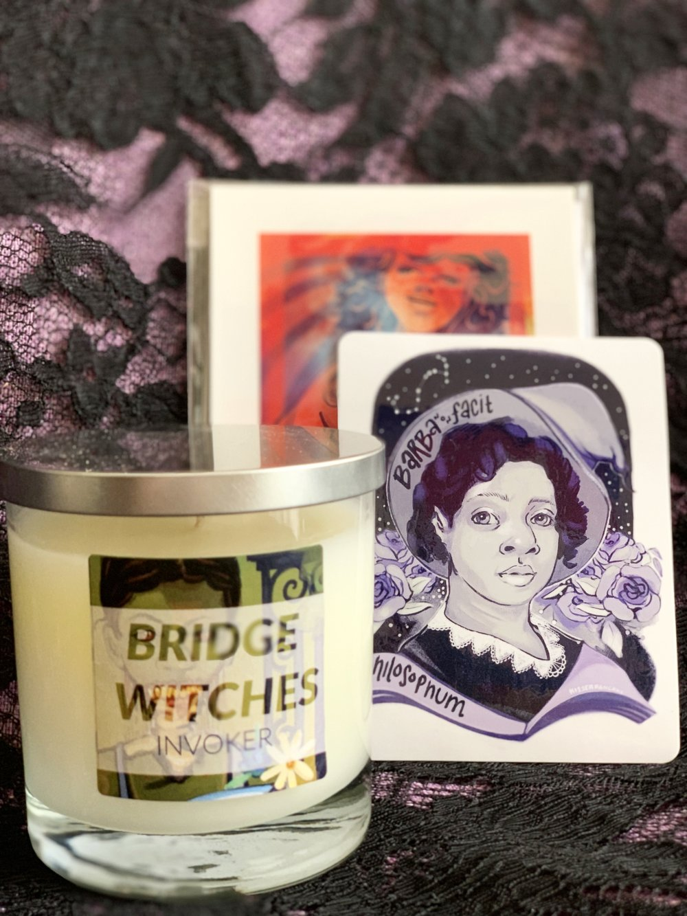 Each Candle Comes with a Mini Print & Sticker ($18)