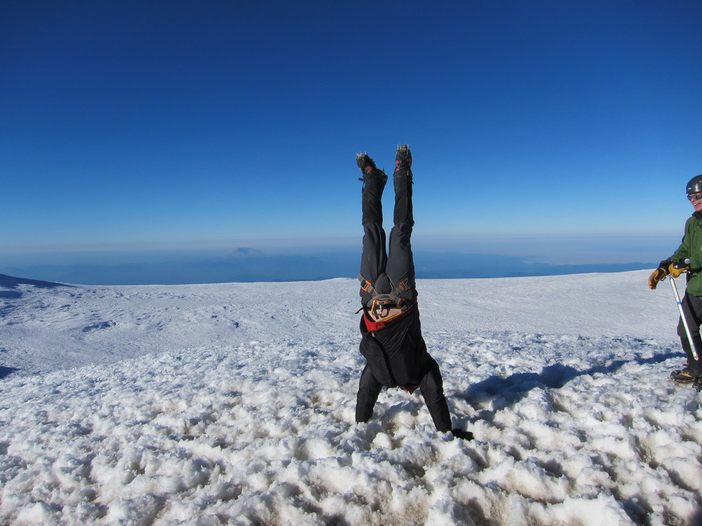Ron doing a handstand at the summit of Mt. Rainier
