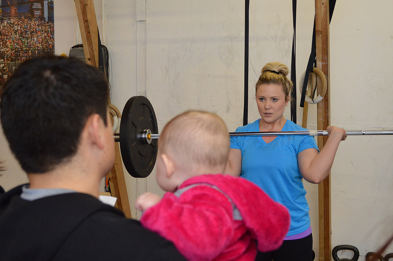 How Great is this picture.  Katie working out with husband Aziz and Hayden watching on.