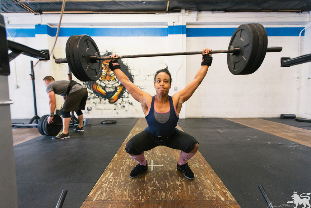 Christine warming up on OH Squat