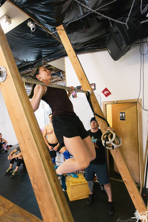Megan knocking out chest to bar pull-ups
