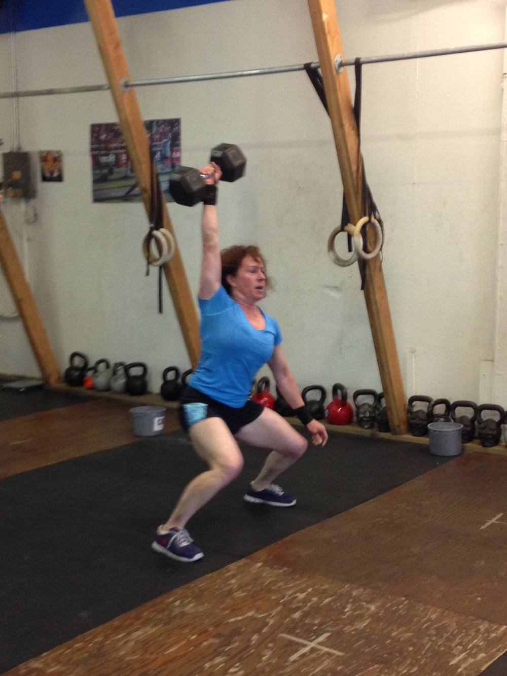 Nicole tearing the 50 pound dumbbell overhead