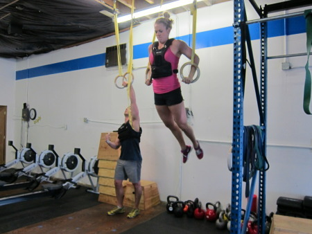 Rory back in May 2011 here at CrossFit Interbay doing Weighted Muscle Ups in a WOD.  She's a beast!!!!