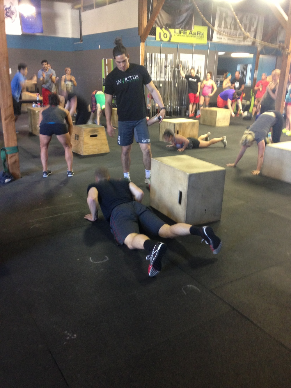 Aja Bartow coached/motivated Tim during the entire 5 minute WOD of max burpee box jump overs.  Lucky Tim