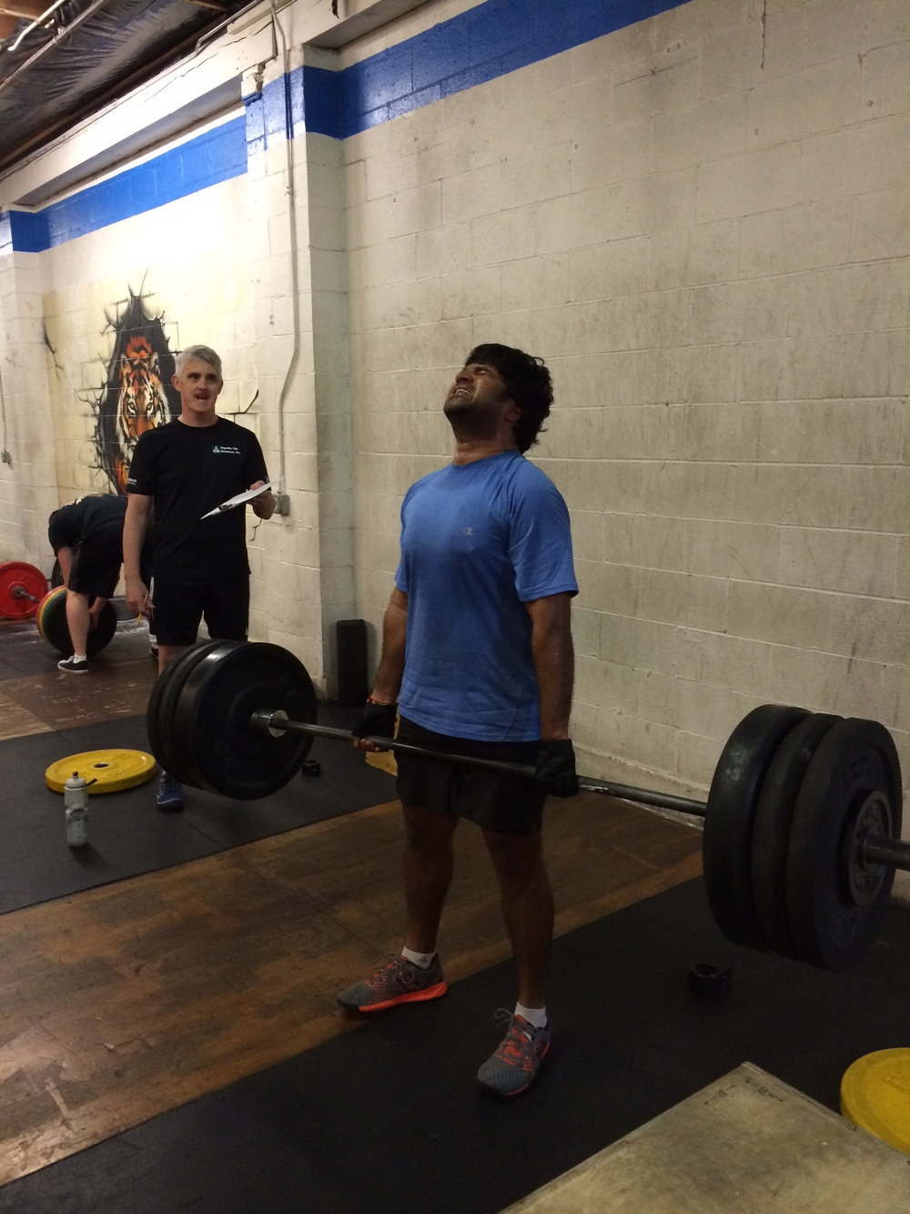 Praveen lifting big weight during the Open.