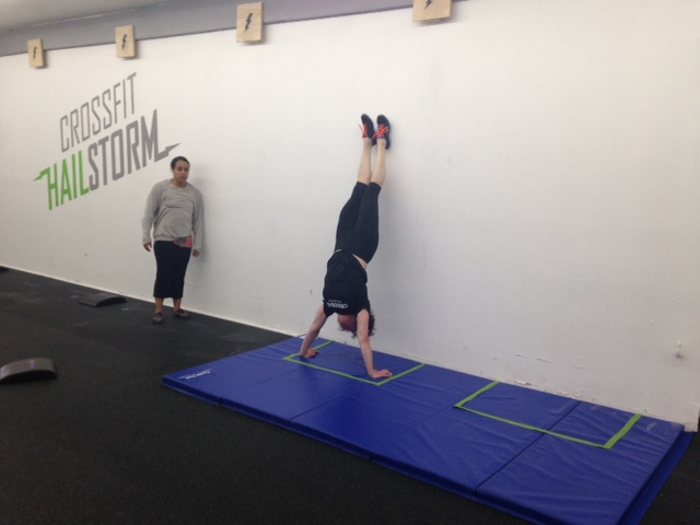 Nicole doing Handstand Push-Ups at Hailstorm on Saturday for the Masters Regional WODs