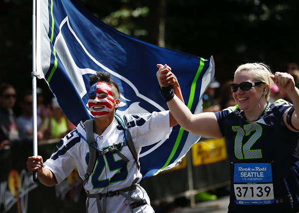 Of course Holly had to run the whole thing with the Seattle Seahawks flag, in a Seahawks Jersey with full face paint.