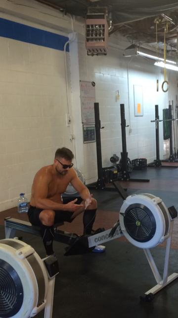 No shirt....Check.  Sunglasses on....Check.  Looking cool....ALWAYS.  Now DK is ready to row.