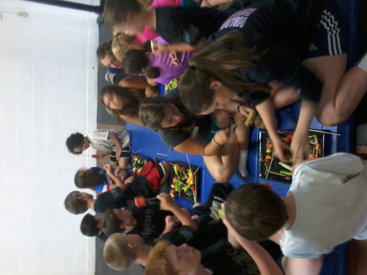 Kids Camp making fruit kabobs after many discussions about nutrition, meals, proper eating and healthy snack choices.