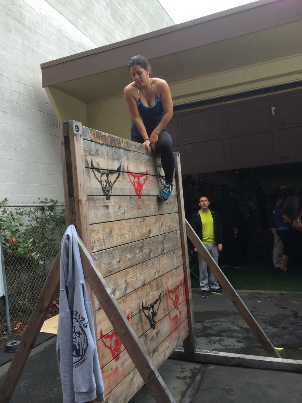 Jen climbing the Wall during the surprise WOD