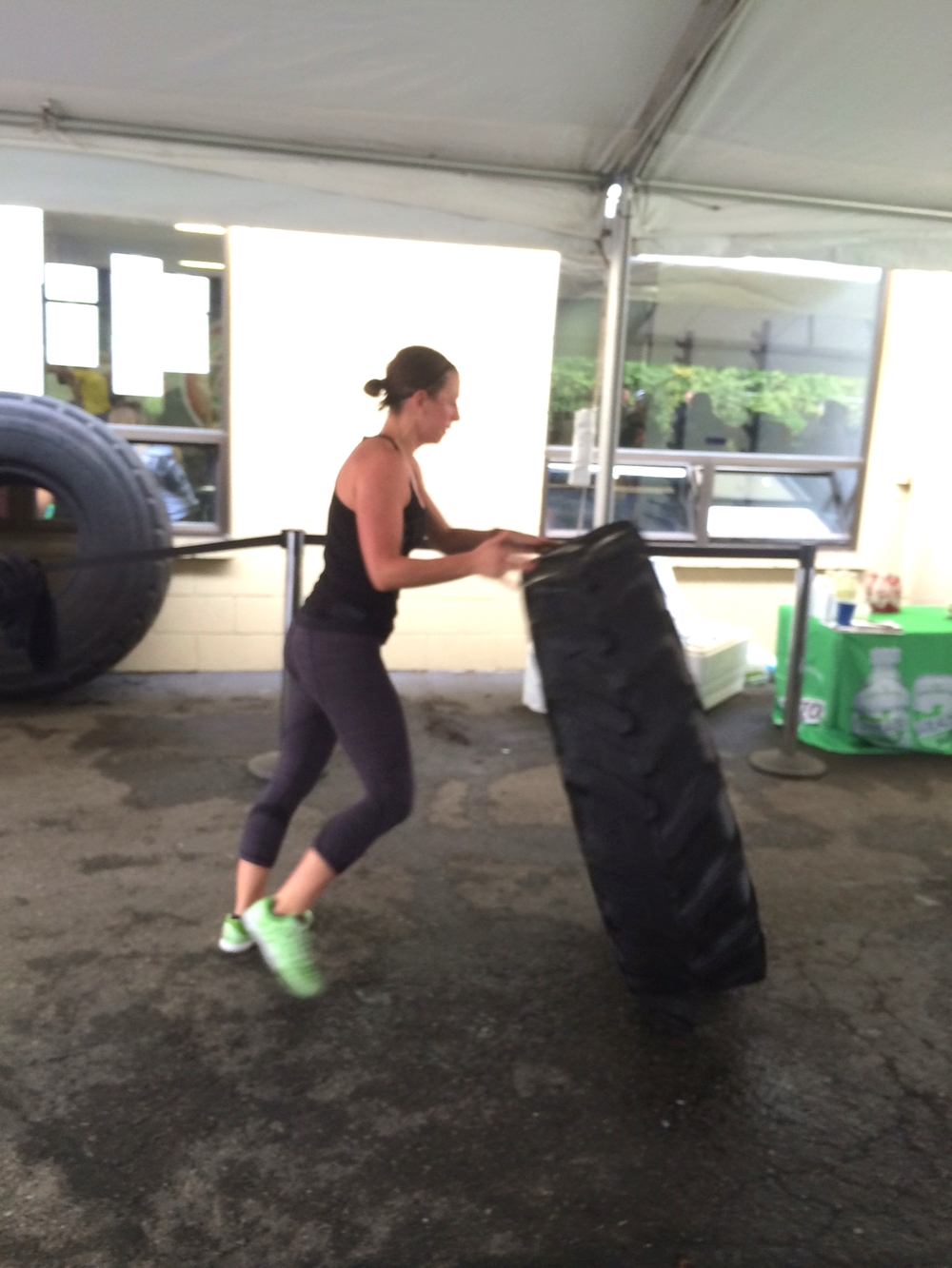 Julia flipping tires during another part of the surprise WOD