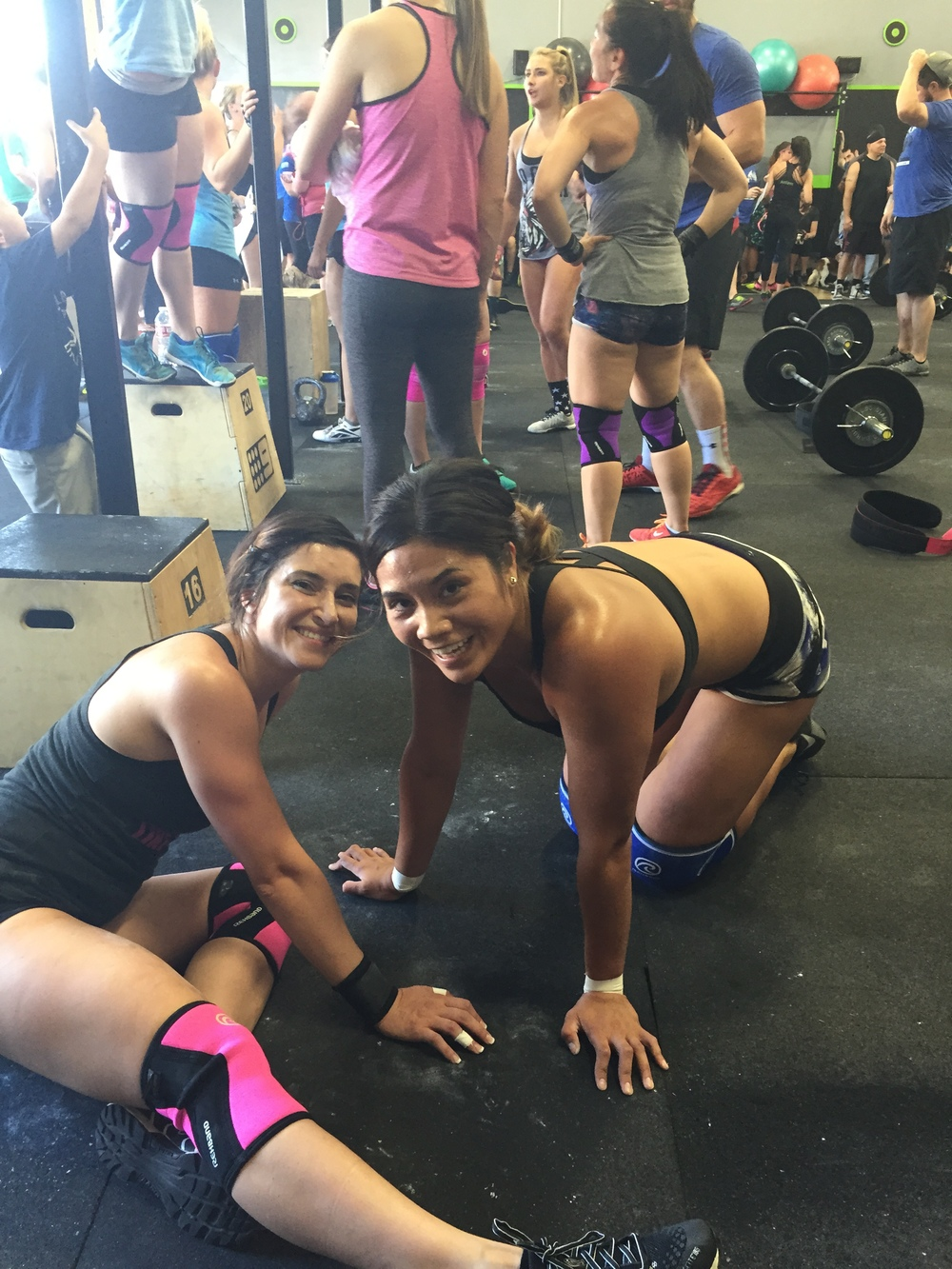 Valery and Kristi immediately after the WOD. No energy to stand up but plenty of energy for a smile.