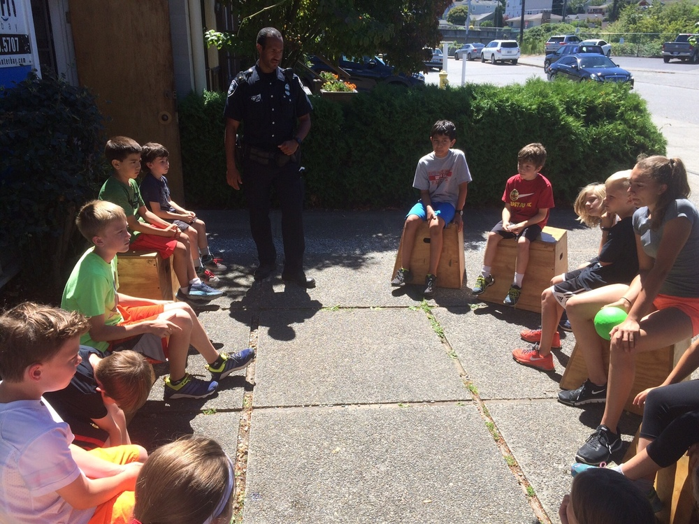 Another popular time is when a Seattle Police Officer talks to the kids about safety and general awareness, plus answers many questions from the kids.