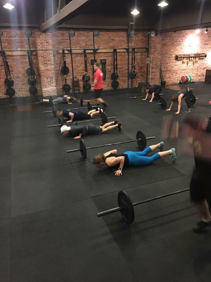 Emily performing a Thruster + Burpee WOD at her level 1 cert.