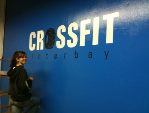 Beth helping paint the front lobby before we were open and she put the logo on the wall. Picture September 2010