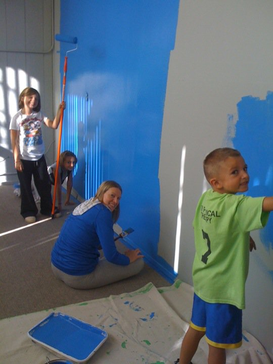 Erin and the kids painting our front office before the grand opening in 2010