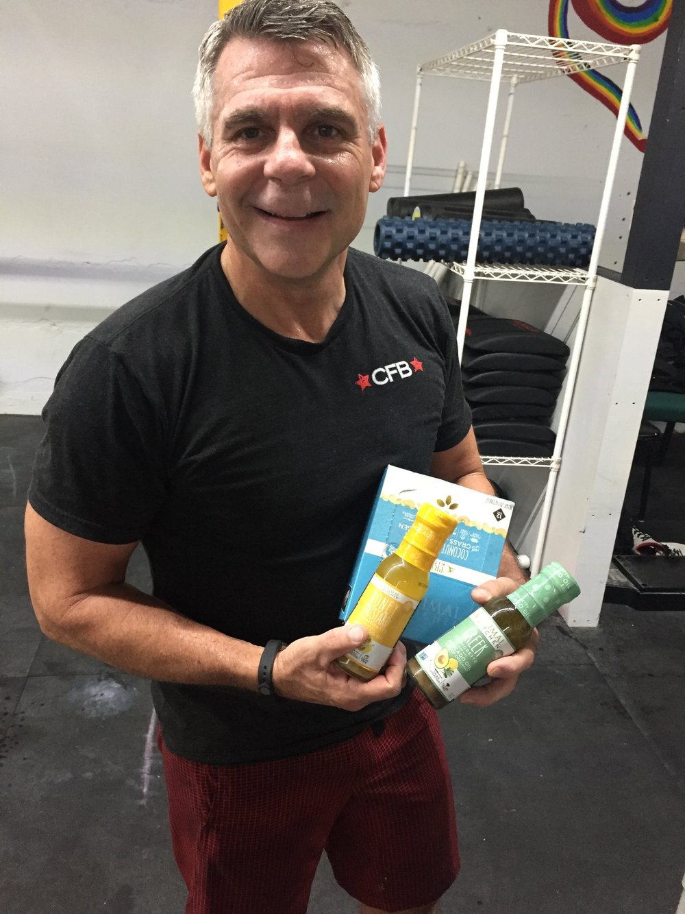 Matt Forshee accepts his Week Five prizes from Primal Kitchen. Avocado oil dressings and coconut cashew protein bars.