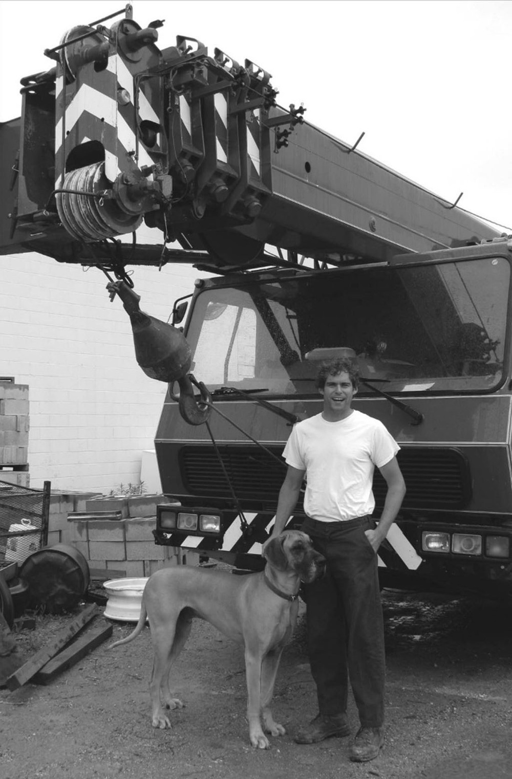Matt Hamilton, CEO of AF Hamilton Crane, standing in front of 100 ton crane with his great dane Harry.   Photo by Bruce Urquhart - Woodstock Sentinal Review 2009