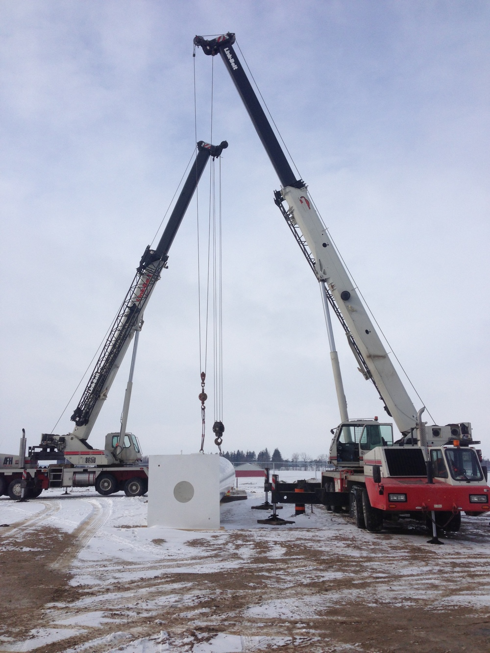 Two cranes are needed to lift propane tank near Listowel