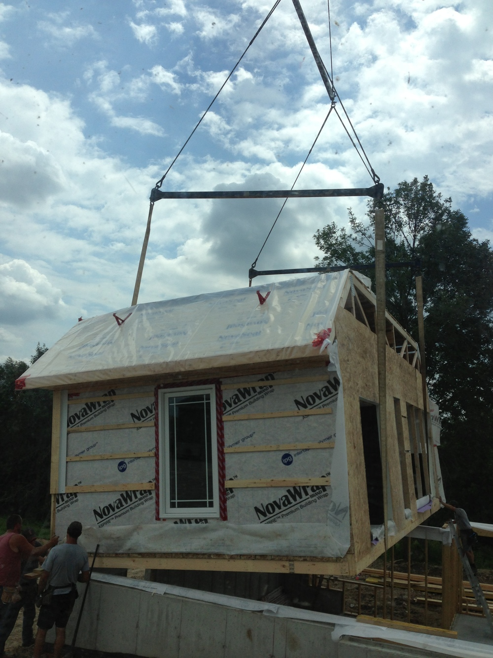 Pre fabricated home being lifted onto foundation by 75 ton crane