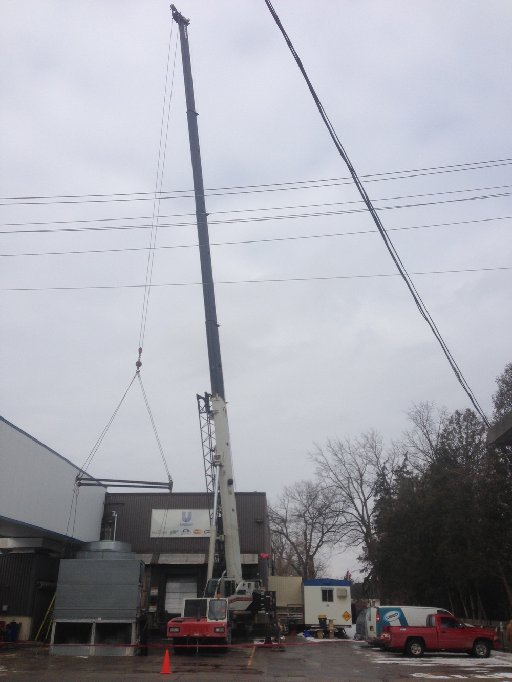 Cooling tower being lifted by a 100 ton crane