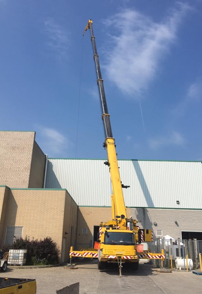 165 ton grove crane hoisting refrigeration unit on arena roof