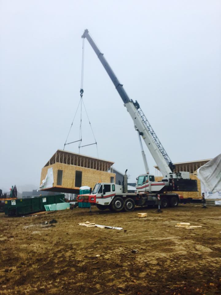 Pre-fab home lifted by mobile crane