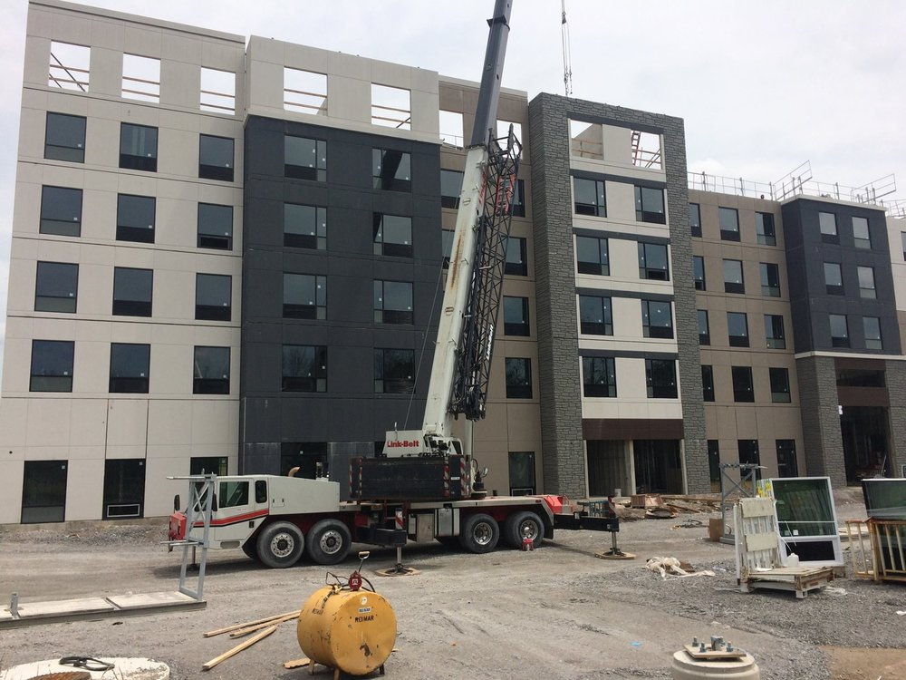 90 ton crane hoisting precast panels onto a hotel