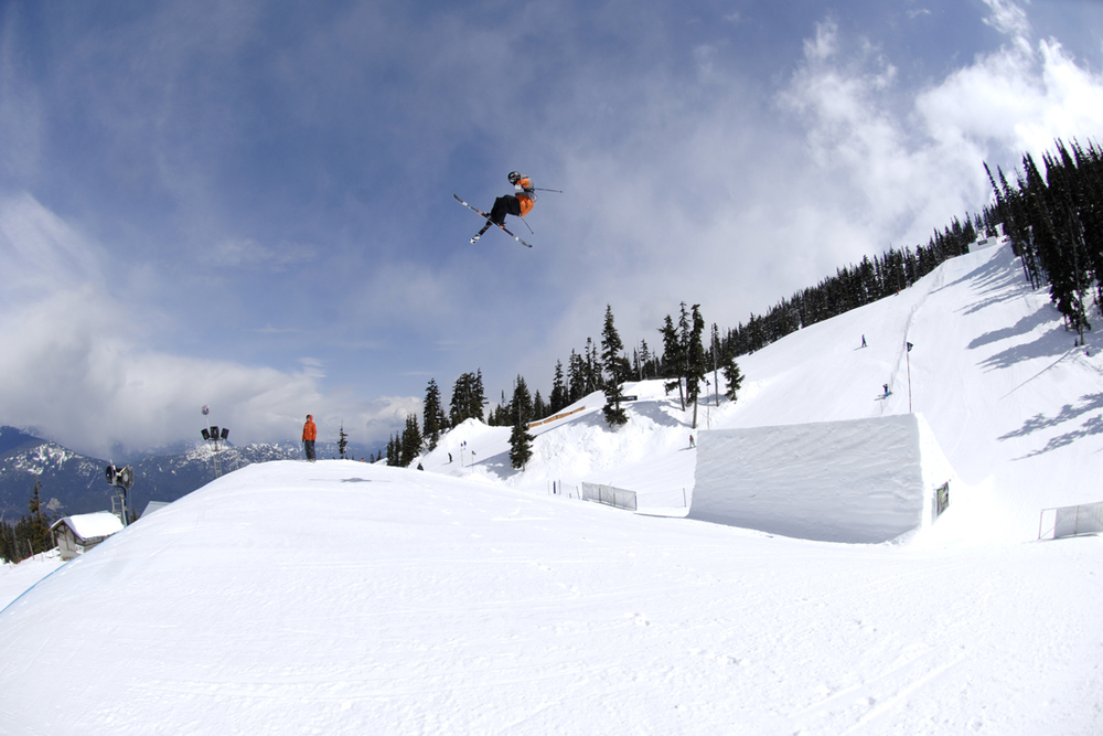 Gus Kenworthy on feature #3 first jump - about 60ft | Photo by: Hank Lampert