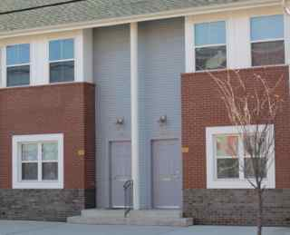Two of the 20 new homes completed on East State Street in 2011, now called Father Brian McCormick Court