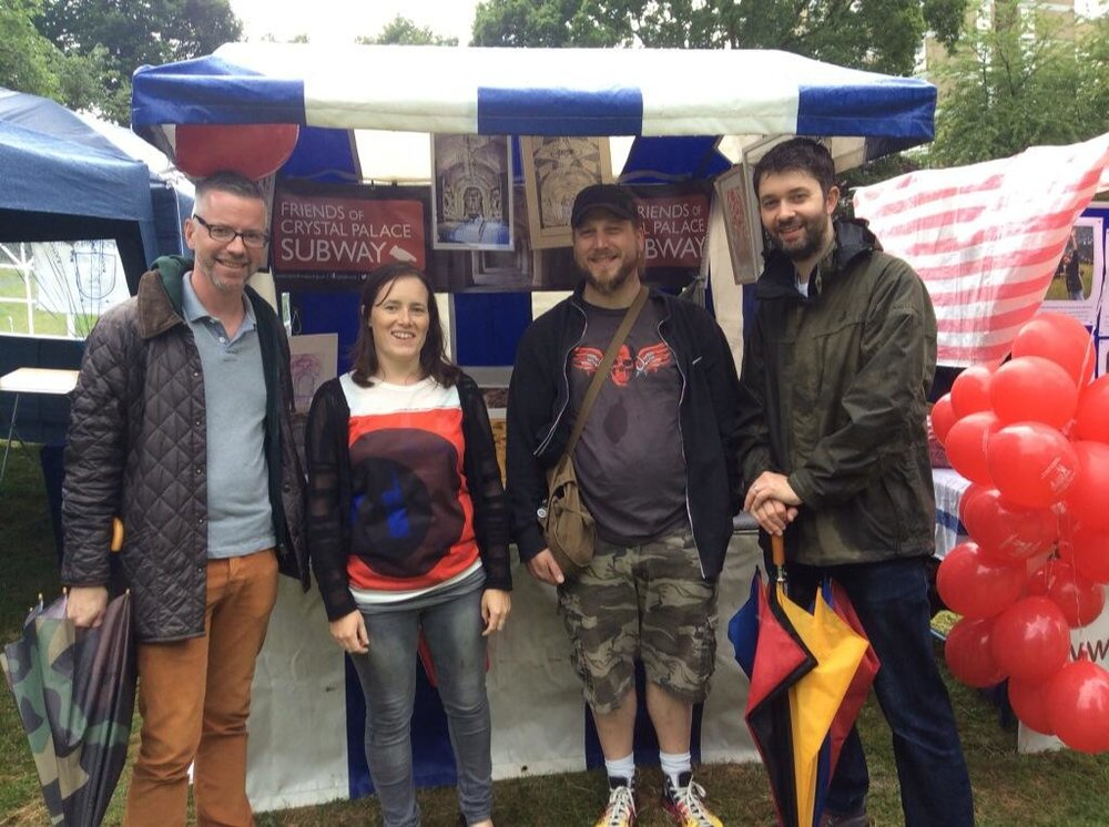 four people at a market stall