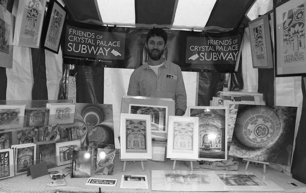 man behind a market stall