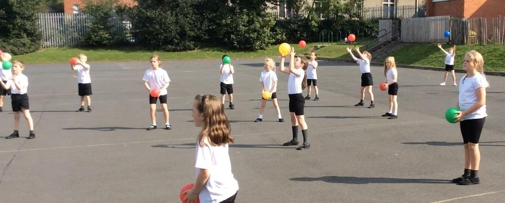 P4 enjoying PE in the playground