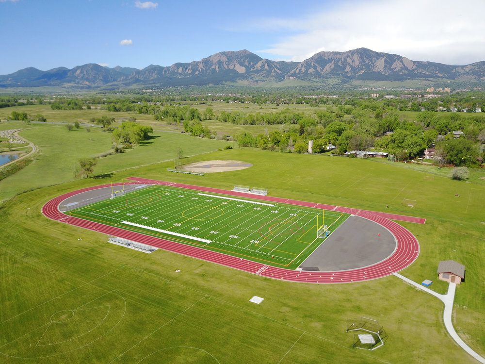 New synthetic turf field at Platt Middle School in Boulder Colorado with the flatirons in background