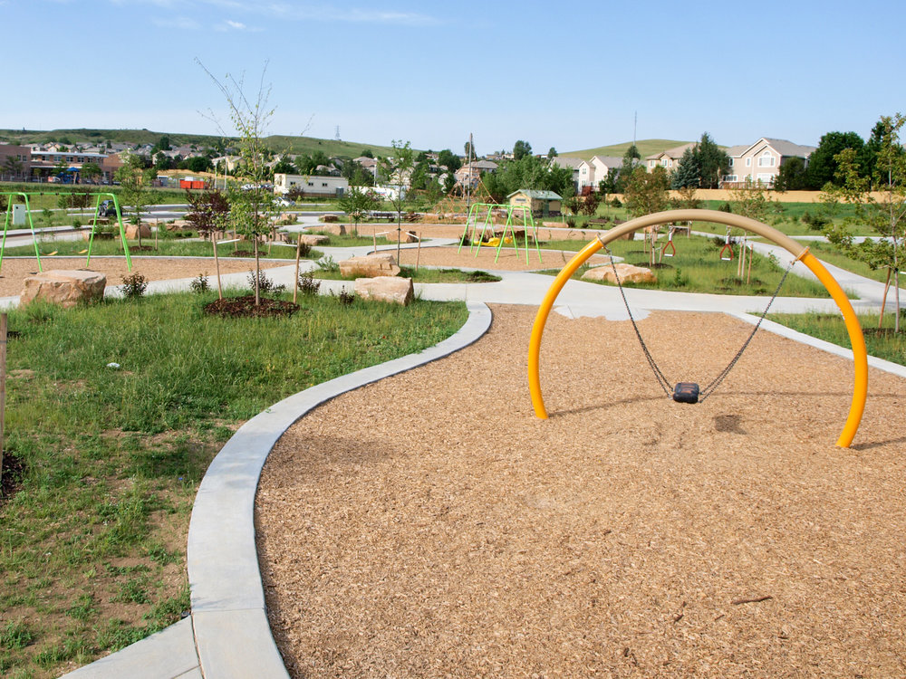 A mix of active play and passive native planting areas make for a natural park setting in Superior Colorado