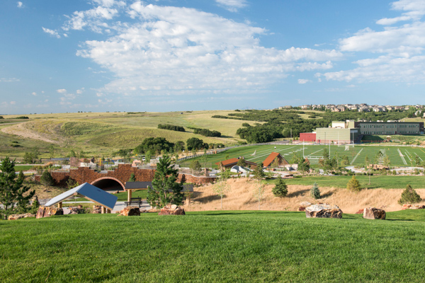 Elk Ridge Park near Denver Colorado with picnic shelters, grass lawn synthetic turf field, nature play, adventure, education detail, construction playground looped paths and trails