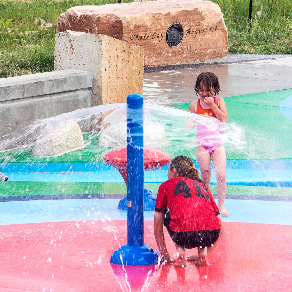 Kids playing with spray ground feature