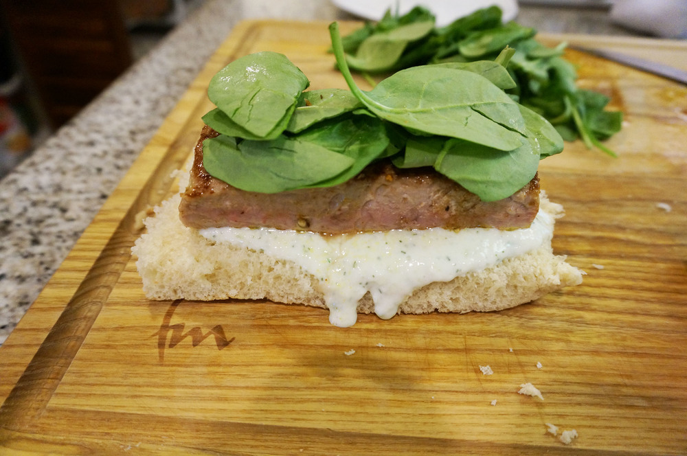 Pile your sandwich as high as you want with raw spinach and the fat free spread.