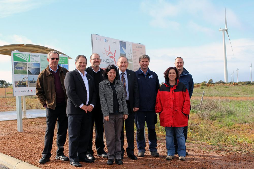 All smiles for an upgraded tourist attraction with the handover of the City's Renewable Energy Hub at Walkaway: Phil Melling, Director Sustainable Communities; Brian Robartson, Manager Economic, Tourism, Property Development; Ken Diehm, City CEO; Rebecca Tuesley, Coordinator Tourism and Geraldton Visitor Centre; Ian Carpenter, City Mayor; Mark Bennett, Natural Wind Service Manager, GE; Hugh Webster, General Manager, Mumbida Wind Farm; and Heidi Janetta, Project Administrator, Mumbida Wind Farm check out the new hub.