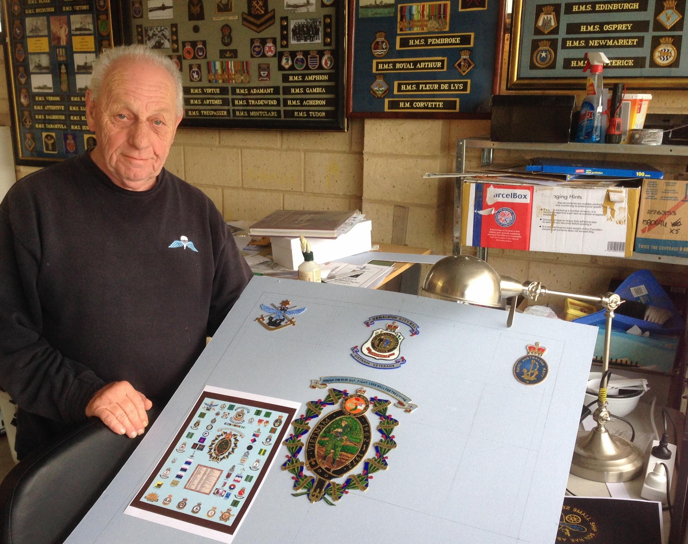 David Burns in his studio, where he creates artistic tributes to the Military.