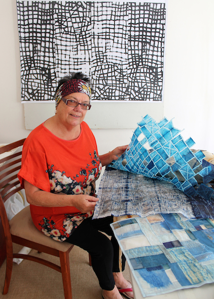 Geraldton artist Marianne Penberthy in her home studio with some of her contemporary Bojagi art.
