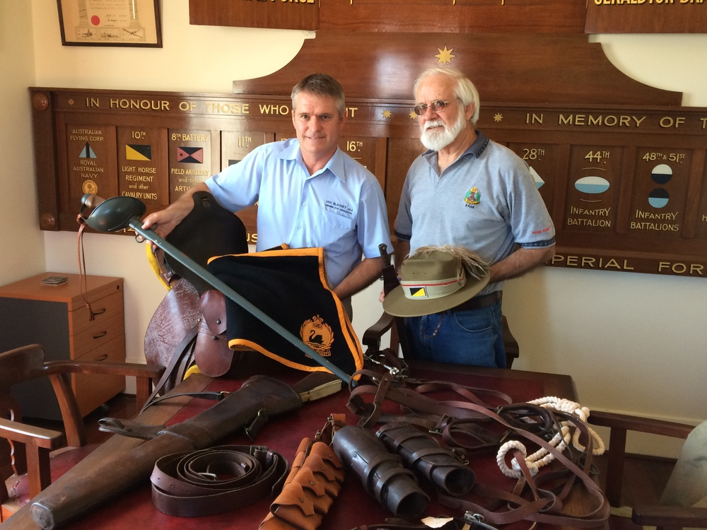Ian Blayney MLA for Geraldton and Barry Stinson from the Geraldton RSL with items Mr Blayney has gifted to the Birdwood Military Museum.