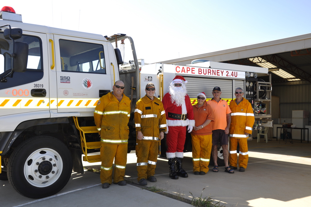 Members of the Cape Burney Bush Fire Brigade with Father Christmas at the Santa Run.