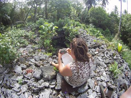 Dr Zoe Richards examining corals at one of the ancient Leluh tombs – photo courtesy Jean-Paul Hobbs.