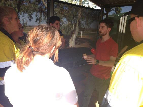 Students speaking with PhD Candidate, Tim Doherty about Feral Cat Ecology.