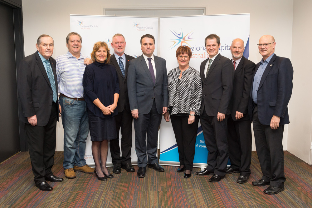 Assistant Minister for Infrastructure and Regional Development, the Hon Jamie Briggs (centre) with Regional Capitals Australia Board members. (L-R): Mayor Ian Carpenter, City of Greater Geraldton; Bruce Anson, Warrnambool City Council; Patience Harrington, City of Wodonga; Ald Albert van Zetten, Launceston City Council; Assistant Minister Briggs; Mayor Deirdre Comerford, RCA Chair and Mayor of Mackay Regional Council; Cr Mathew Dickerson, Dubbo City Council; Cr Michael Fraser, City of Wodonga; Phil Pinyon, Wagga Wagga City Council